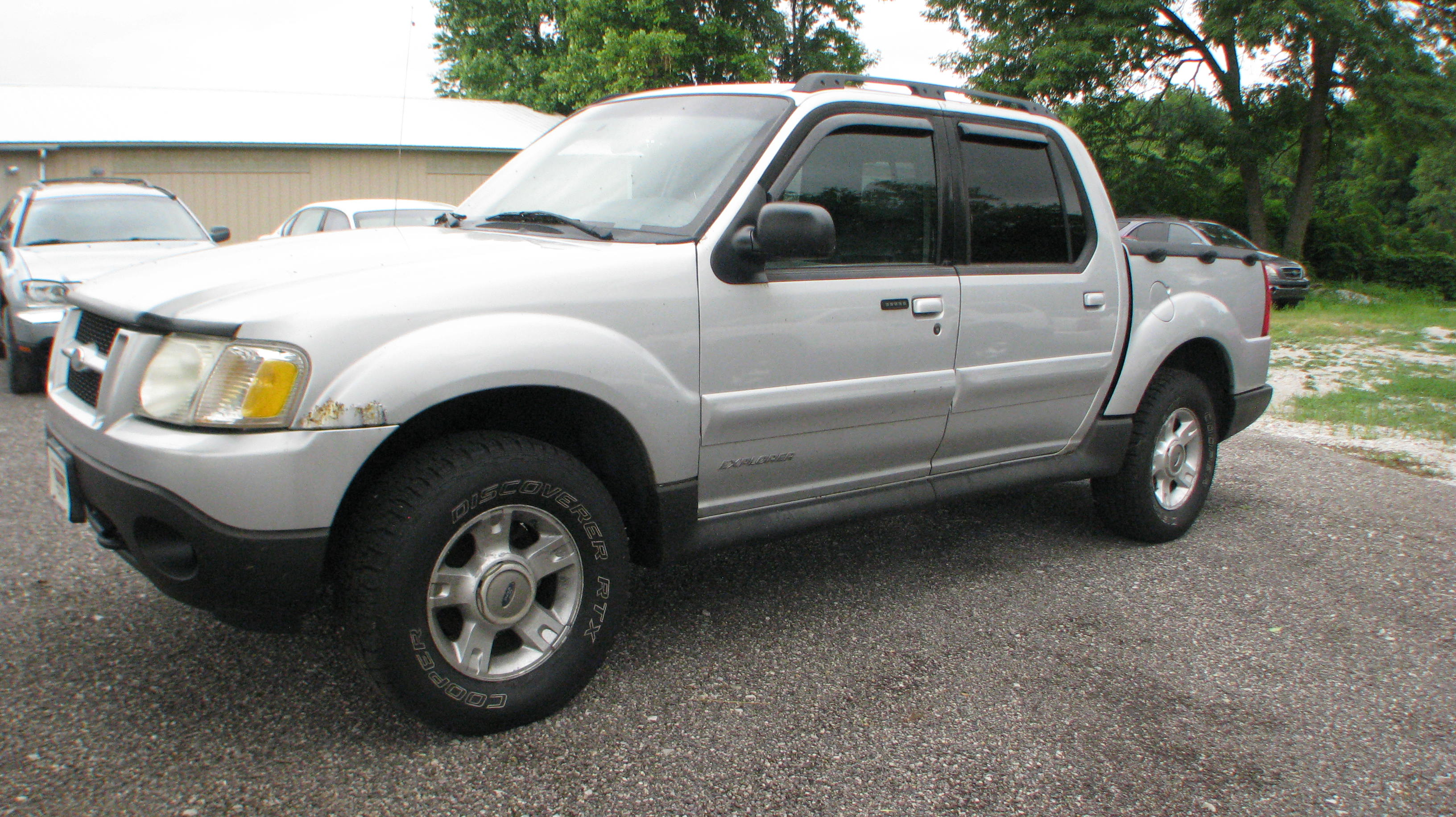 Pre owned 2002 ford explorer sport trac 4d suv 4wd